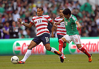 MEXICO CITY, MEXICO - AUGUST 15, 2012:  Jermaine Jones (13) of the USA MNT turns the ball away from Angel Reyna (10) of  Mexico during an international friendly match at Azteca Stadium, in Mexico City, Mexico on August 15. USA won 1-0.