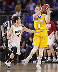 SIOUX FALLS, SD: MARCH 6: Madison Guebert #11 of South Dakota State sheilds the ball from IUPUI defender Holly Hoopingarner #4 during the Summit League Basketball Championship on March 6, 2017 at the Denny Sanford Premier Center in Sioux Falls, SD. (Photo by Dick Carlson/Inertia)