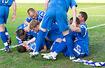 Hibs v St Johnstone.....30.04.11.Kevin Moon is mobbed by his team mates after scoring a late winner.Picture by Graeme Hart..Copyright Perthshire Picture Agency.Tel: 01738 623350  Mobile: 07990 594431