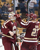 Patrick Brown (BC - 23) celebrates the win with Thatcher Demko (BC - 30). - The Boston College Eagles defeated the Boston University Terriers 3-1 (EN) in their opening round game of the 2014 Beanpot on Monday, February 3, 2014, at TD Garden in Boston, Massachusetts.