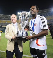 DC United forward Luciano Emilio (11) holds the Lamar Hunt US. Open Cup with President and CEO Kevin Payne after the win, DC United defeated The Charleston Battery 2-1, to win the  Lamar Hunt U.S. Open Cup at RFK Stadium in Washington DC, Saturday September 3, 2008.