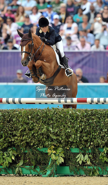 Edwina Tops-Alexander riding Itot du Chateau (AUS, Australia). Team Showjumping - PHOTO: Mandatory by-line: Garry Bowden/SIP/Pinnacle - Photo Agency UK Tel: +44(0)1363 881025 - Mobile:0797 1270 681 - VAT Reg No: 768 6958 48 - 06/08/2012 - 2012 Olympics - Greenwich Park, London, England