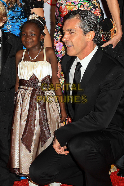 Antonio Banderas.Children's Hospital Los Angeles Gala: Noche de Ninos, Los Angeles, California, USA, 20th October 2012..half length black suit tie kneeling .CAP/ADM/PH.©Paul A. Hebert/AdMedia/Capital Pictures.