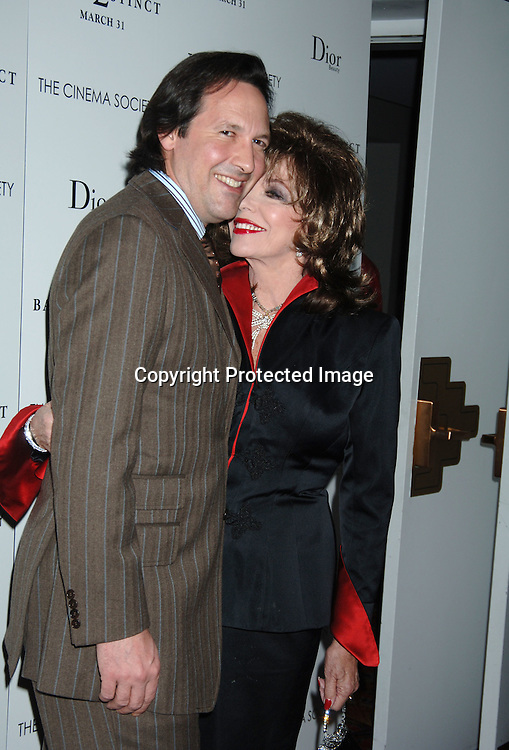 "Percy Gibson and wife Joan Collins ..at The Wolld Premiere of ""Basic Instinct 2"" starring ..Sharon Stone and David Morrissey on March 27, 2006..at The Loews Lincoln Square Theatre. ..Robin Platzer, Twin Images"