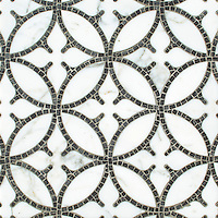 Omar, a hand-cut and waterjet stone mosaic, shown in polished Calacatta Tia and hand-chopped tumbled Cavern, is part of the Legend™ collection by New Ravenna.