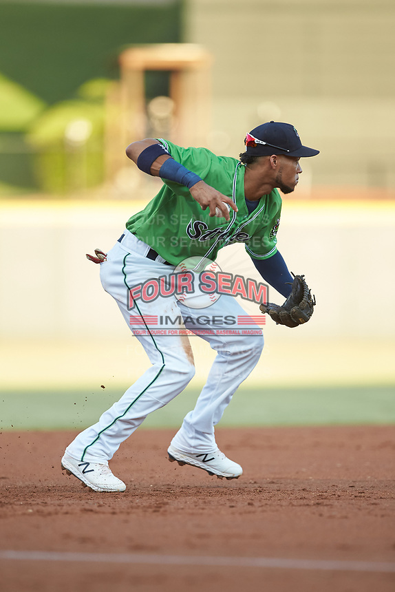 Gwinnett Stripers third baseman Pedro Florimon (18) prepares to make a throw to second base against the Scranton/Wilkes-Barre RailRiders at BB&T BallPark on August 16, 2019 in Lawrenceville, Georgia. The Stripers defeated the RailRiders 5-2. (Brian Westerholt/Four Seam Images)