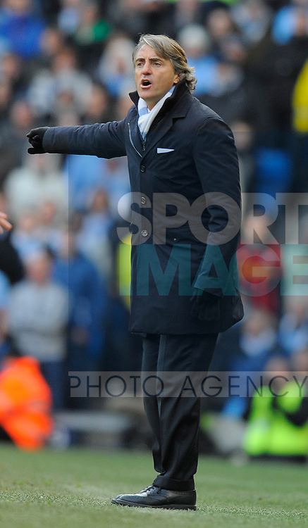 Roberto Mancini manager of Manchester City on the touchline.Barclays Premier League.Manchester City v Tottenham at the Eithad Stadium, Manchester 22nd January, 2012..Sportimage +44 7980659747.picturedesk@sportimage.co.uk.http://www.sportimage.co.uk/.Editorial use only. Maximum 45 images during a match. No video emulation or promotion as 'live'. No use in games, competitions, merchandise, betting or single club/player services. No use with unofficial audio, video, data, fixtures or club/league logos.