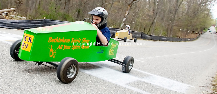 BETHLEHEM CT- 27 APRIL 2008- 042708JT04-<br /> Dennis Spezzano crosses the finish line during his soapbox race against fellow Pack 459 Boy Scout Tyler Milek during Sunday's annual Downhill Derby on Hard Hill Road South in Bethlehem.<br /> Josalee Thrift / Republican-American