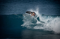Surfer at Hookipa Beach. Maui, Hawaii