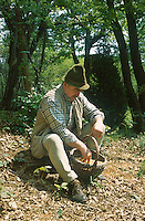 Josko Sirk sitting in the woods with a basket full of corn for the local animals, mainly deer and badger
