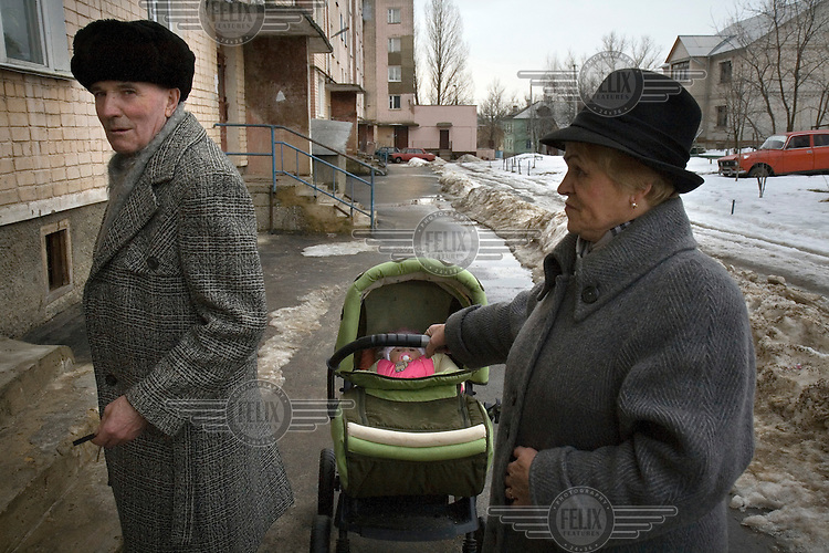 In a housing estate in Oryol city, capital of the Oryol province, grand parents push a baby in a pram. Oryol is one of the poorer regions in Russia.