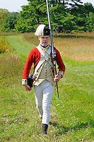 Soldier of His Majesty's 62nd Regiment of Foot marches during exercises at a Revolutionary War encampment at Freeman's Farm, site of a major British defeat in September 1777, Saratoga National Historical Park, Stillwater, New York, USA.