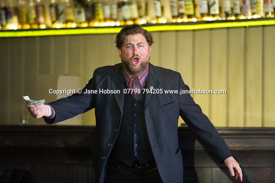 """London, UK. 30.09.2014. English National Opera's production of """"The Girl of the Golden West"""", by Giacomo Puccini, directed by Richard Jones, conducted by Keri-Lynn Wilson, opens at London Coliseum. Picture shows: Craig Colclough (Jack Rance). Photograph © Jane Hobson."""