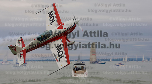 Zoltan Veres presents his routine flight just before the start of the 40th Blue Ribbon Regatta race with 570 participating yachts sailing the 160 km course around Lake Balaton near Balatonfured.