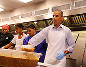 United States President Barack Obama with daughter Malia Obama, and, from left, Jamillah Linkins and Marianne Ali, participate in a service project at DC Central Kitchen, on Saturday, September 10, 2011, in Washington, DC. .Credit: Leslie E. Kossoff / Pool via CNP