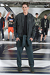 Model Tres poses in a waxed nylon bomber in spruce, neoprene warm-up suit in spruce, and linen sweater t-shirt in navy, from the Perry Ellis Spring 2017 collection by Michael Maccari, on July 11th 2017, during New York Fashion Week Men's Spring Summer 2017.