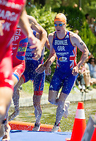 02 JUN 2013 - MADRID, ESP - Jonathan Brownlee (GBR) (right) of Great Britain leaves the water at the end of the first swim lap during the men's ITU 2013 World Triathlon Series round in Casa de Campo, Madrid, Spain (PHOTO (C) 2013 NIGEL FARROW)