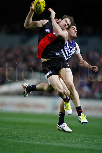 23.06.2012 Subiaco, Australia. Fremantle v Essendon. Stewart Crameri cops a whack to the head from Garrick Ibbotson during the Round 13 game played at Patersons Stadium.