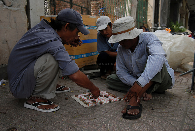 Men play a Vietnamese board game in Ho Chi Minh City, Vietnam.