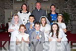The pupils from Kilmoyley NS who made their First Holy Communion, on Saturday in St Brendan's Church, Ardfert.Front l-r Megan Moloney, Sam McElligott and Shannon Sheehan. Centre l-r: Jessica O'Sullivan, Ronan Walsh, Kellie Meehan and Ellen Cooke. Back l-r: A?ine Crowe (principal), Fr Ted Fitzgerald and Eibhlain Lovett(teacher)...