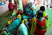 Patients and their family members sleep on the floor while they wait to meet the doctors during the OPD hours in Duncan Hospital in Raxaul of East Champaran district of Bihar, India. Photograph: Sanjit Das/Panos for Legatum Foundation