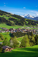 Austria, Tyrol, Westendorf (Tyrol): Hiking Village at Brixen Valley with parish church St Nicolas, snowcapped Kitzbuhel mountains at background | Oesterreich, Tirol, Westendorf (Tirol): Wanderdorf im Brixental mit Pfarrkirche St. Nikolaus, im Hintergrund die schneebedeckten Kitzbueheler Alpen