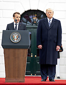 President Emmanuel Macron of France, left, makes remarks as United States President Donald J. Trump, right, listens at an arrival ceremony on the South Lawn of the White House in Washington, DC on Tuesday, April 24, 2018.<br /> Credit: Ron Sachs / CNP