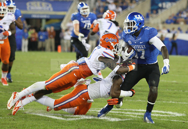 Kentucky Wildcats wide receiver Alexander Montgomery (17) gets tackled by Florida defense during the second half of the UK vs. UF football game at Commonwealth Stadium in Lexington, Ky., on Saturday, September 28, 2013. UK lost 24-7. Photo by Tessa Lighty | Staff