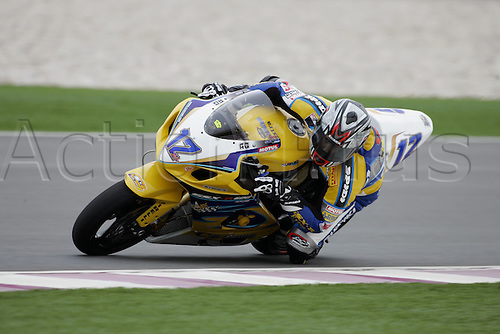 25 February 2005:  Spanish rider Xavi Fores (ESP) on his Alstare Suzuki Corona Extra GSX600R during qualifying practice for round one of the SBK Supersport World Championship held at the Losail International Circuit, Doha, Qatar. Photo: Neil Tingle/Action Plus..050225 motorcycling motorcycle racing bike racing SBK sport motor sports motorsport motorsports