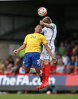 Taylor Moore (Bristol City) of England & Richarlison of Brazil go for the ball during the International match between England U20 and Brazil U20 at the Aggborough Stadium, Kidderminster, England on 4 September 2016. Photo by Andy Rowland / PRiME Media Images.