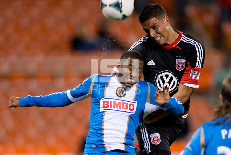 Luis Silva (12) of D.C. United goes up for a header with Raymon Gaddis (28) of the Philadelphia Union during a Major League Soccer game at RFK Stadium in Washington, DC. D.C. United tied the Philadelphia Union, 1-1.