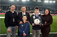 SWANSEA, WALES - MARCH 16: Matchball sponsor with Lee Trundle<br /> Re: Premier League match between Swansea City and Liverpool at the Liberty Stadium on March 16, 2015 in Swansea, Wales