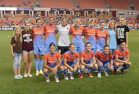 Team photo of the Houston Dash with special guests prior to their game with the Chicago Red Stars on Saturday, April 16, 2016 at BBVA Compass Stadium in Houston Texas.
