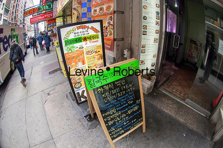 Bustling activity in the Koreatown or Little Korea neighborhood in Midtown Manhattan in New York on Friday, March 22, 2013. (© Richard B. Levine)