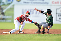 Batavia Muckdogs second baseman Iramis Olivencia (49) tags out Taylor Gushue (13) attempting to steal during a game against the Jamestown Jammers on July 25, 2014 at Dwyer Stadium in Batavia, New York.  Batavia defeated Jamestown 7-2.  (Mike Janes/Four Seam Images)