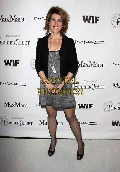 NIA VARDALOS.3rd Annual Women In Film Pre-Oscar Party held At A Private Residence, Bel Air, California, USA..March 4th, 2010.full length black jacket grey gray dress fishnet tights peep toe shoes silver necklace .CAP/ADM/KB.©Kevan Brooks/AdMedia/Capital Pictures.