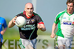 Jerome Flynn Milltown-Castlemaine in action against David O'Callaghan Saint Brendans in the First Round of the Kerry Senior Football Championship at Milltown on Sunday.