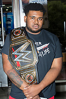 "Olajuwon Somerville, 25, of Springfield, Mass., holds a replica WWE Championship belt as he poses for a portrait before a WWE Live Summerslam Heatwave Tour event at the MassMutual Center in Springfield, Massachusetts, USA, on Mon., Aug. 14, 2017. Asked why he has the belt, Somerville said, ""It just makes me look cool."" When asked about current WWE Champion Jinder Mahal, who is not a fan favorite, Somerville shrugged and said, ""He's doing his own thing. I think I could be a better champion."""