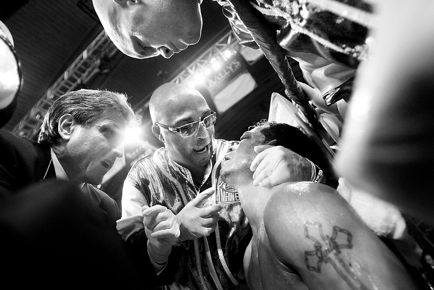 "ARTURO GATTI (10/12) -- Arturo stumbled back to his corner after somehow surviving a vicious beating in the sixth round, trainer Buddy McGirt (center) tells the champ he's going to stop the fight. Gatti, at first pleads to go one more round, but finally looks up and relents, saying to McGirt, ""OK. I trust you coach."" .The fight was over.  ATLANTIC CITY, NJ  6/25/05"