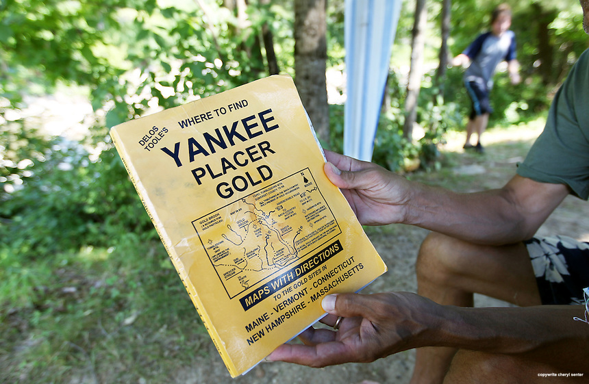 Jim Somers of Amesbury, MA, holds a well worn Yankee Placer Gold map book, in Bath, N.H., Friday, July 13, 2012.  (Cheryl Senter for the Boston Globe)