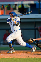 Edul Escobar #11 of the Burlington Royals follows through on his swing against the Kernersville Bulldogs in an exhibition game at Burlington Athletic Stadium June20, 2010, in Burlington, North Carolina.  Photo by Brian Westerholt / Four Seam Images