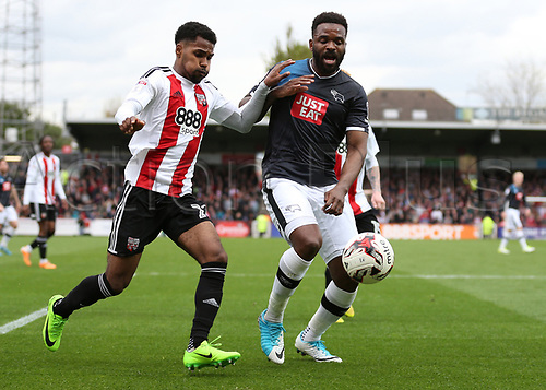 April 14th 2017,  Brent, London, England; Skybet Championship football, Brentford versus Derby County; Darren Bent of Derby County and Rico Henry of Brentford compete for the ball