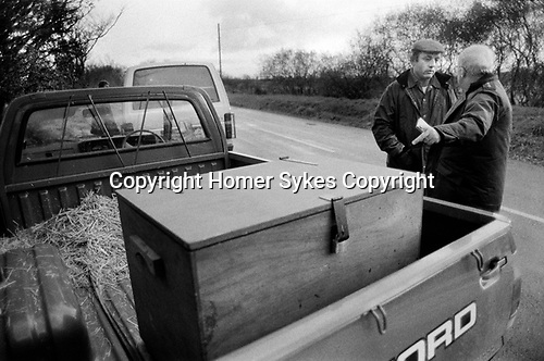 Puppy Farming Wales 1989. RSPCA inspector Peter Anderson stops a know puppy breeder with dog 	carrying box in the rear of his van. There are no air holes.