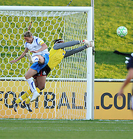 Washington Freedom goalkeeper Briana Scurry (1) battles a flying Boston Breakers midfielder Kristine Lilly to make a spectacular save. Boston Breakers defeated Washington Freedom 3-1 at The Maryland SoccePlex, Saturday April 18, 2009.