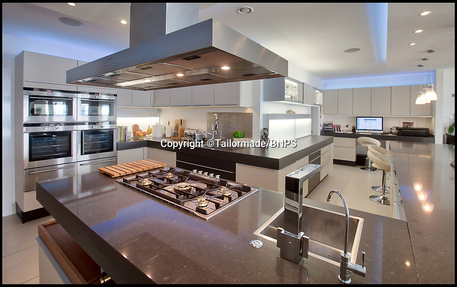 BNPS.co.uk (01202) 558833<br /> Pic: Tailormade/BNPS<br /> <br /> State of the art kitchen...<br /> <br /> tunning super home for sale - If you've got £9 million to spare...<br /> <br /> This state of the art mega-home is for sale on the exclusive millionaires playground of Sandbanks in Poole, Dorset.<br /> <br /> The biggest, most expensive, and luxurious home ever to come on the market on the tiny peninsula, it is now selling for a cool £8.75m.<br /> <br /> Called The Moorings, the harbour front mansion has stunning sea views, and is on one of the most enviable plots on Millionaire's Row.<br /> <br /> Its owners, entrepreneur Chris Thomas and wife Sue, spent a staggering £5.5m building the palatial home that has been compared to a five star hotel.<br /> <br /> Spread over 13,000 sq ft - the equivalent size of seven detached houses - the state-of-the art property comes with five en suite bedrooms, three reception rooms, an office, cinema room, indoor swimming pool, sauna, gym, gate house and boat house.