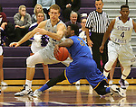 SIOUX FALLS, SD - NOVEMBER 24: Bryant Allen #3 from Dakota State University keeps control of the ball as Jordan Stotts #44 from the University of Sioux Falls  defends in the first half of their game Monday night at the Stewart Center.  (Photo by Dave Eggen/Inertia)