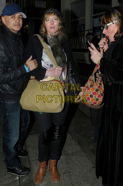 Anna Winslet spotted in Soho, London, England..17th February 2012.full length black grey gray green bag purse brown boots bag purse .CAP/IA.©Ian Allis/Capital Pictures.