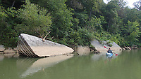 NWA Democrat-Gazette/FLIP PUTTHOFF <br /> Slabs of rock add to the scenery and provide cover for fish Aug. 16 2019 on the War Eagle River. Alan Bland of Rogers paddles on the quiet river.