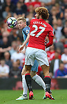 Kevin De Bruyne of Manchester City and Marouane Fellaini of Manchester United during the Premier League match at Old Trafford Stadium, Manchester. Picture date: September 10th, 2016. Pic Simon Bellis/Sportimage