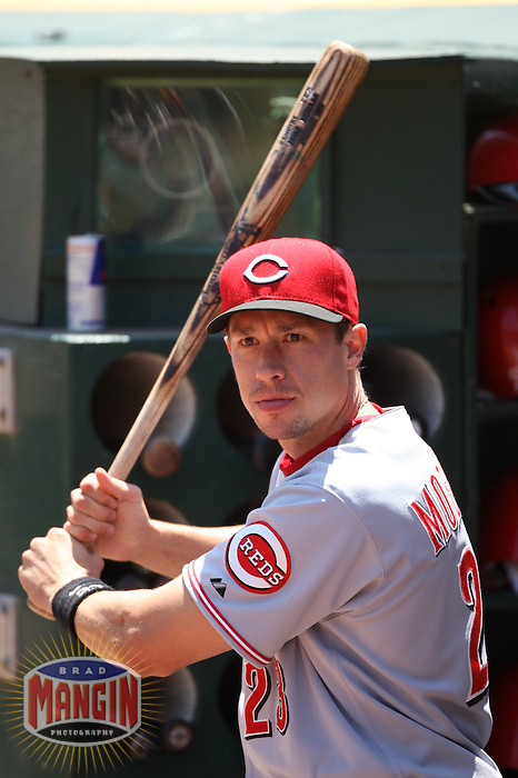 OAKLAND, CA - June 20:  Chad Moeller of the Cincinnati Reds prepares in the dugout before the game against the Oakland Athletics at the McAfee Coliseum in Oakland, California on June 20, 2007. Photo by Brad Mangin
